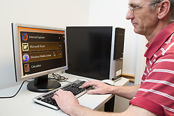 Computer class for people with visual impairments - man using computer with enlarged text.