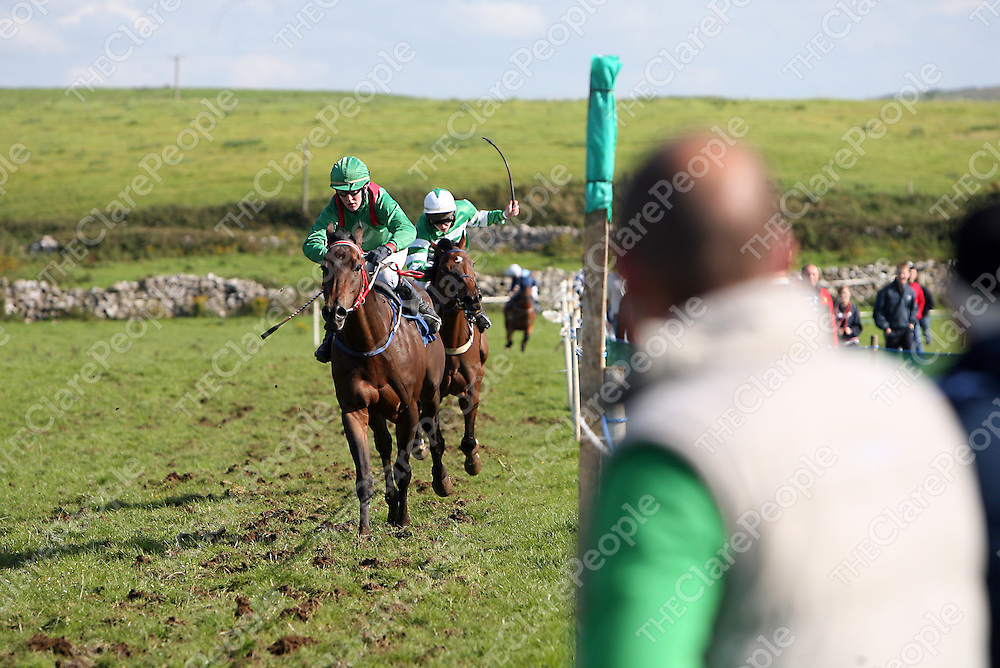 Timmy Carroll on Reverse the Hearse and Darren Harrison on He's Sound cross the line first and second in the fifith at the annual Lisdoonvarna races at the weekend.<br />
