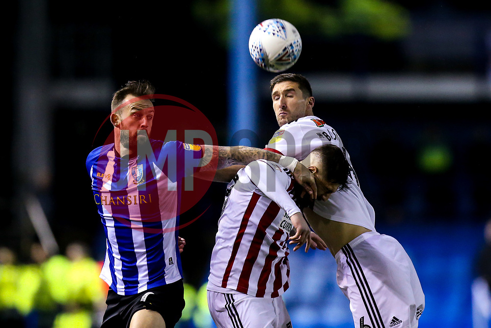 Steven Fletcher of Sheffield Wednesday challenges Kieron Freeman of Sheffield United and Chris Basham of Sheffield United - Mandatory by-line: Robbie Stephenson/JMP - 04/03/2019 - FOOTBALL - Hillsborough - Sheffield, England - Sheffield Wednesday v Sheffield United - Sky Bet Championship