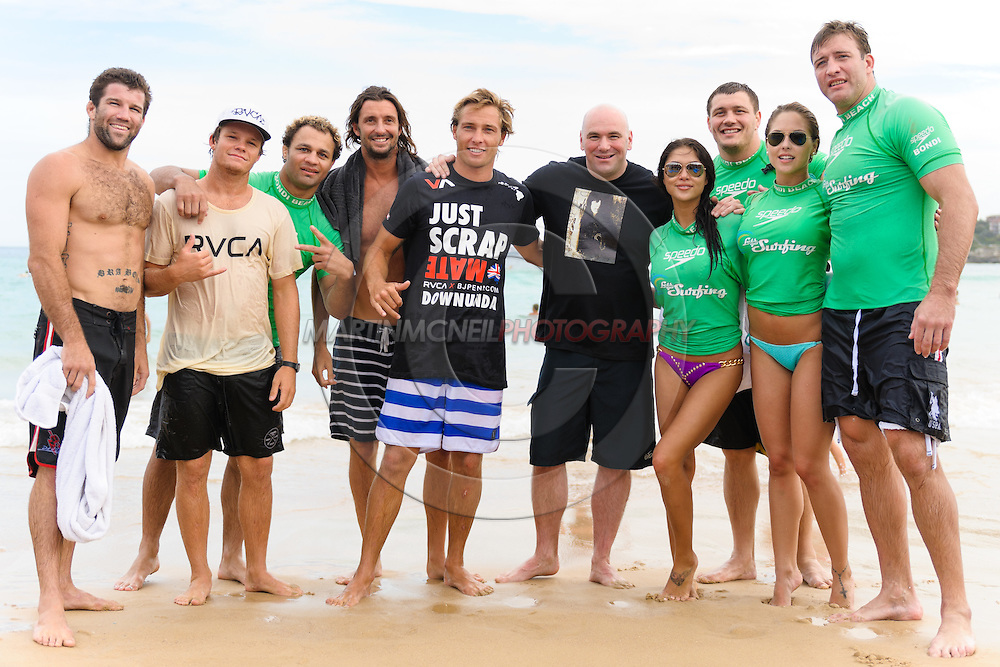 SYDNEY, AUSTRALIA, FEBRUARY 25, 2011: UFC president Dana White (center right) poses with fightes, octagon girls and surfing instructors on Bondi Beach in Sydney, Australia on February 25, 2011.