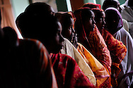 Voters line up to cast their ballots at a polling station during the second phase of voting in parliamentary elections April 23, 2009 in the Muslim dominated town of Mukalmua in the state of Assam, India. Polling took place amid tight security after several acts of militant violence in recent days.