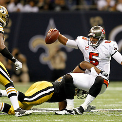 November 6, 2011; New Orleans, LA, USA; New Orleans Saints defensive end Cameron Jordan (94) tackles Tampa Bay Buccaneers quarterback Josh Freeman (5) during the second quarter of a game at the Mercedes-Benz Superdome. Mandatory Credit: Derick E. Hingle-US PRESSWIRE