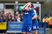 AFC Wimbledon defender Luke O'Neill (2) with head in hands after miss during the EFL Sky Bet League 1 match between AFC Wimbledon and Bolton Wanderers at the Cherry Red Records Stadium, Kingston, England on 7 March 2020.