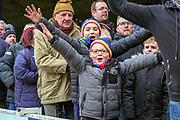 AFC Wimbledon fans celebrating during the EFL Sky Bet League 1 match between Southend United and AFC Wimbledon at Roots Hall, Southend, England on 16 March 2019.