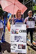 Roma 18 Giugno 2015<br /> Manifestazione degli Animalisti Italiani,  vicino all'ambasciata della Cina, per protestare  contro il  Festival di Yulin che si terrà il 21 giugno. Yulin è una metropoli cinese di 5 milioni e mezzo di abitanti, dove il 21 giugno di ogni anno, per il solstizio d'estate, si celebra un Festival per il quale vengono macellati e poi mangiati circa 10mila cani.<br /> Rome June 18, 2015<br /> Animal rights activists demonstrated, near the Embassy of China, to protest against the Festival of Yulin to be held on June 21. Yulin is a Chinese metropolis of 5 million and a half inhabitants, where on June 21 of each year, for the summer solstice, is celebrated a festival for which are then slaughtered and eaten about 10 thousand dogs.