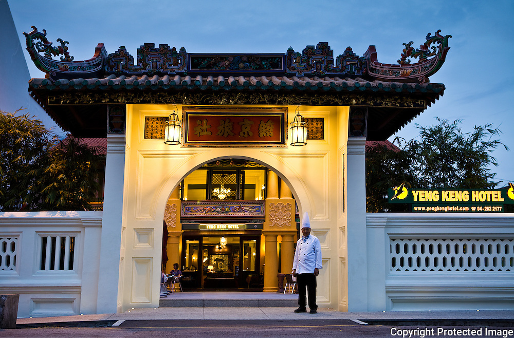 historic entryway of Yeng Keng Hotel with the hotel's chef