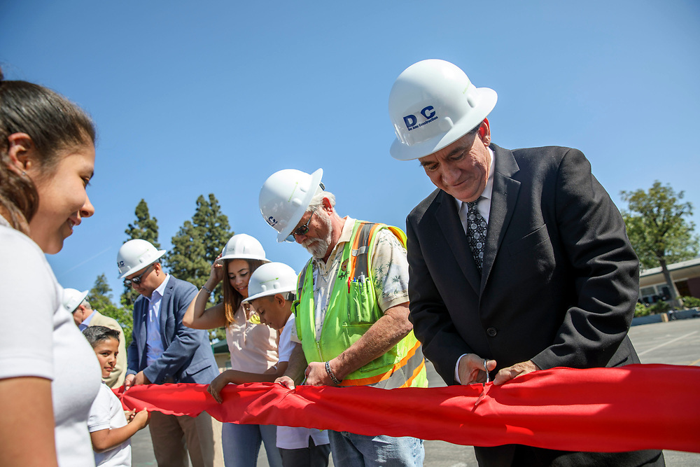 Mark Hovatter, chief facilities executive of Los Angeles Unified School District (LAUSD), cuts a ribbon during a celebration at Vaughn Next Century Learning Center on Friday, April 21, 2017 in San Fernando, Calif. A new project will provide upgraded classrooms on an L.A. Unified campus that hosts a charter school, replacing 21 old portable classrooms with new construction classrooms made with recycled shipping containers. © 2017 Patrick T. Fallon