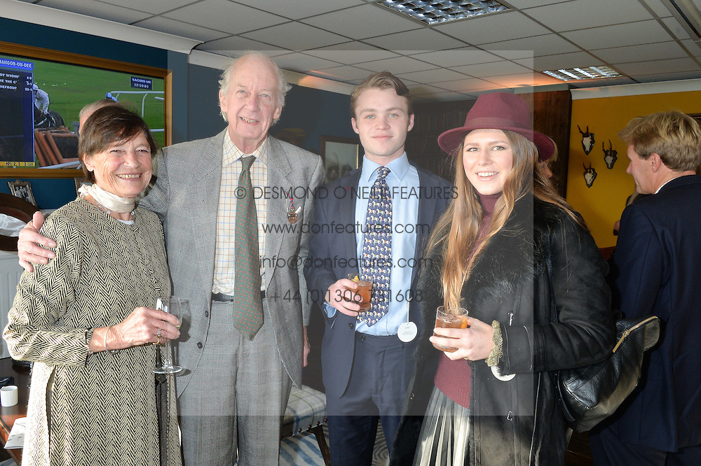 Left to right, VISCOUNT & VISCOUNTESS MARCHWOOD, his grandson JAKE WILLIS FLEMING and CORINTHIA PEARSON at the 2014 Hennessy Gold Cup at Newbury Racecourse, Newbury, Berkshire on 29th November 2014.  The Gold Cup was won by Many Clouds ridden by Leighton Aspell.