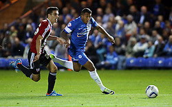 Peterborough United's Nathaniel Mendez-Laing in action with Brentford's Raphael Calvet - Photo mandatory by-line: Joe Dent/JMP - Tel: Mobile: 07966 386802 08/10/2013 - SPORT - FOOTBALL - London Road Stadium - Peterborough - Peterborough United V Brentford - Johnstone's Paint Trophy