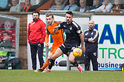 14th April 2018, Tannadice Park, Dundee, Scotland; Scottish Championship football, Dundee United versus Falkirk; eghan Tumilty of Falkirk and Paul McMullan of Dundee United