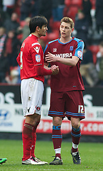 LONDON, ENGLAND - Saturday, March 5, 2011: Tranmere Rovers' Ash Taylor shakes hands with Charlton Athletic's Miguel Angel Llera after their 1-1 draw during the Football League One match at The Valley. (Photo by Gareth Davies/Propaganda)