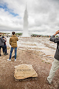 Selfoss, Iceland - July 17, 2016: The Strokkur geyser erupts in Selfoss Iceland. Strokkur is a fountain geyser located in a geothermal area beside the Hvítá River.