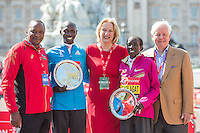 Wilson Kipsang of Kenya (centre), winner of the Elite Men's race and Edna Kiplagat of Kenya, winner of the Elite Women's race joined by President Uhuru Kenyatta of Kenya, Virgin Money CEO Anne Gadhia and London Marathon Chairman John Spurling on the podium at the Virgin Money London Marathon 2014 at the finish line on Sunday 13 April 2014<br />