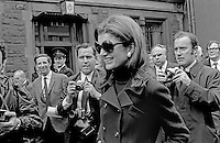 Jacqueline Kennedy Onassis, aka Jackie Kennedy, on a trip to Belfast, N Ireland, UK, with her husband, Aristotle Onassis, the Greek shipping magnate, who was visiting  local shipbuilders, Harland & Wolff, on 5th September 1970.  The picture was taken in Queen Street, Belfast, where she and her husband were entertained to a buffet lunch in the Harland & Wolff Social Club. The photo         includes Belfast Telegraph journalist, Barry White, Bob Renton, staff photographer, Daily Express, RUC  Detective Chief Inspector Cecil Patterson, behind  Jackie Onassis and in front of barred window, and Eddie Harvey, staff photographer, Belfast Newsletter. 197009050347a <br /> <br /> Copyright Image from Victor Patterson,<br /> 54 Dorchester Park, <br /> Belfast, UK, BT9 <br /> <br /> t1: +44 28 9066 1296 (from Rep of Ireland 048 90661296)<br /> t2: +44 28 9002 2446 (from Rep of Ireland 048 9002 2446)<br /> <br /> m: +44 7802 353836<br /> <br /> e: victorpatterson@me.com<br /> www.victorpatterson.com<br /> <br /> Please see my Terms and Conditions of Use at www.victorpatterson.com. It is IMPORTANT that you familiarise yourself with them.<br /> <br /> Images used on the Internet must be visibly watermarked i.e. © Victor Patterson<br /> within the body of the image and copyright metadata must not be deleted. Images <br /> used on the Internet have a size restriction of 4kbs and will be chargeable at current<br />  NUJ rates unless agreed otherwise.<br /> <br /> This image is only available for the use of the download recipient i.e. television station, newspaper, magazine, book publisher, etc, and must not be passed on to any third <br /> party. It is also downloaded on condition that each and every usage is notified within 7 days to victorpatterson@me.com<br /> <br /> The right of Victor Patterson to be identified as the author is asserted in accordance with The Copyright Designs And Patents Act (1988). All moral rights are asserted