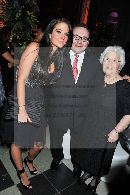 Left to right, TULISA CONTOSTAVLOS, JONATHAN SHALIT and SOPHIE SHALIT at the 50th birthday party for Jonathan Shalit held at the V&A Museum, London on 17th April 2012.