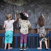 Link&ouml;ping, Sweden, August 19, 2012. Children play in the outdoor space at Stolplyckan, the second biggest collective in Sweden with 184 apartments. <br /> <br /> Link&ouml;ping, Svezia, Agosto 2012. Bambini giocano negli spazi comuni del collettivo Stolplyckan, il secondo pi&ugrave; grande collettivo abitativo della Svezia, con un totale di 184 appartamenti.