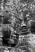 Cambodia.<br /> Two heads at the Bayon in Angkor Thom.