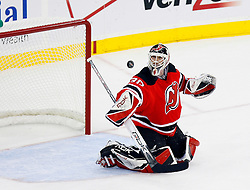 April 9, 2008; Newark, NJ, USA;  New Jersey Devils goalie Martin Brodeur (30) makes a blocker save during the first period of game 1 of the Eastern Conference Quarterfinal playoffs at the Prudential Center in Newark, NJ.