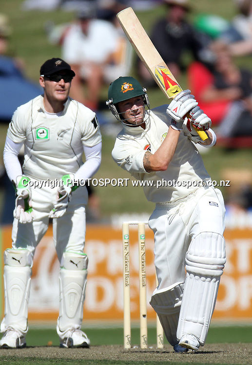 Australia's Michael Clarke hits a catch to Tim Southee as Brendon Mc Cullum looks on.<br />