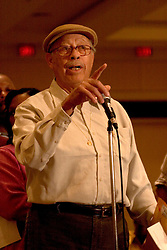 16 December, 05. New Orleans, Louisiana. <br /> Resident Clarence Barrow, who lost everything during hurricane Katrina raises serious insurance issues at the Mayor's 'town hall meeting,' at the Sheraton hotel. Barrow claims that State Farm insurers are hounding him to pay a new premium on a home that no longer exists whilst denying his claim for the total loss of his bought and paid for property.<br /> Photo; ©Charlie Varley/varleypix.com