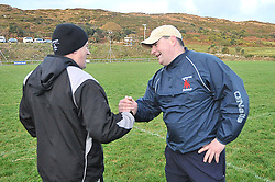 Sharing the spoils... Eddie and JP Walsh shake hands at full time after the Connemara and Westport junior league game finished in a draw.<br /> Pic Conor McKeown