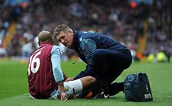 Aston Villa's Fabian Delph receives medical attention - Photo mandatory by-line: Harry Trump/JMP - Mobile: 07966 386802 - 29/04/15 - SPORT - FOOTBALL - Birmingham - Villa Park - Aston Villa v Everton - Barclays Premier League