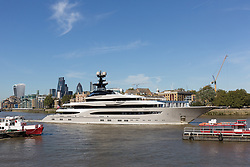 October 3, 2016 - London, London, UK - LONDON, UK.  Superyacht, Kismet leaves London on the River Thames passing in front of the City of London skyline during blue skies and sunny autumn weather this lunchtime, after mooring at Butlers Wharf last week. Kismet is 308 feet long and is reportedly owned by Pakistani-American billionaire Shahid Khan, who owns the National Football League (NFL) team, the Jacksonville Jaguars, who played the Colts in an International Series game at Wembley yesterday. Kismet has 6 staterooms, with the master bedroom having its own private deck with jacuzzi and helipad and can be chartered for an estimated £1m per week. (Credit Image: © Vickie Flores/London News Pictures via ZUMA Wire)