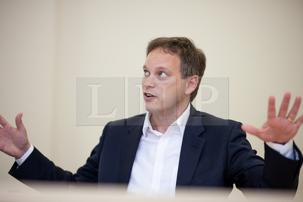 © Licensed to London News Pictures . FILE PHOTO DATED 23/10/2012 . Oldham , UK . GRANT SHAPPS , Cabinet Office Minister without Portfolio , Conservative Party Co-Chairman and MP for Welwyn Hatfield , photographed during an interview for the Manchester Evening News . Mr Shapps has complained to the BBC Trust about an Email he received ahead of his appearance on Question Time from BBC Head of Public Affairs , Julia Ockenden , which made reference to an unbroadcast Newsnight investigation in to Jimmy Savile .  Photo credit : Joel Goodman/LNP