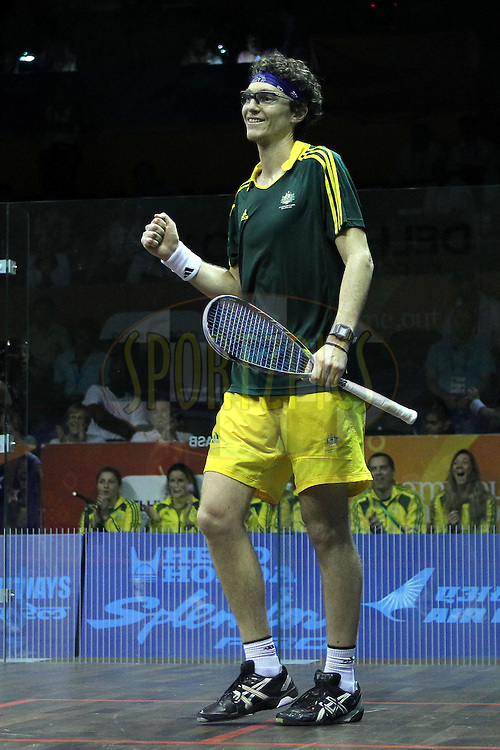 Cameron Pilley of Australia celebrates winning the gold medal by beating Joelle King and Martin Knight of New Zealand during the final of the mixed doubles squash competition held at the Siri Fort Complex in New Delhi as part of the XIX Commonwealth Games, India on the 13 October 2010..Photo by:  Ron Gaunt/photosport.co.nz