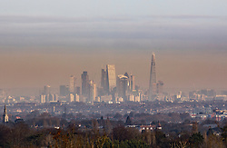 © Licensed to London News Pictures. 03/01/2017. Epsom, UK. Pollution envelopes the City of London - seen from 16 miles away on the North Downs at Epsom - on a day of below freezing temperatures. Last week it was reported that parts of the capital had exceeded their annual air pollution limits five days into 2017. Photo credit: Peter Macdiarmid/LNP