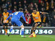 Hull City striker Abel Hernandez (9) takes on Brighton central midfielder, Dale Stephens (6) during the Sky Bet Championship match between Hull City and Brighton and Hove Albion at the KC Stadium, Kingston upon Hull, England on 16 February 2016.