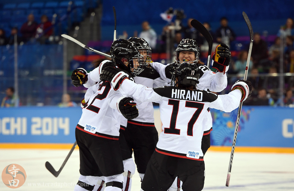 Feb 16, 2014; Sochi, RUSSIA; Japan forward Yuka Hirano (17) celebrates with teammates after scoring a goal against Russia in a women's ice hockey classifications round game during the Sochi 2014 Olympic Winter Games at Shayba Arena.