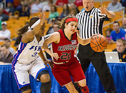 Bridgeport guard Gianina Renzelli (20) dribbles past Fairmont Senior guard Tyaira Horton (3) during a first round game at the Charleston Civic Center.