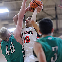 Grants Pirate Matt Vail (10) is fouled by Moriarty Pinto Joseph Kaberlein (40) as he attempts a layup Saturday at Grants High School.