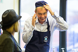© Licensed to London News Pictures . 24/11/2015 . Oldham , UK .  Liberal Democrat leader TIM FARRON working in the kitchen serving lunch whilst campaigning at St Thomas CofE Primary School in the seat of Oldham West and Royton , with candidate Jane Brophy , in a by-election triggered by the death of MP Michael Meacher . Photo credit : Joel Goodman/LNP