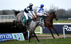 Mr Mix ridden by Stuart Robinson (left) and Upswing ridden by Jack Andrews compete in the Overbury Stud Willoughby De Broke Open Hunters' Chase during Midlands Raceday at Warwick Racecourse.