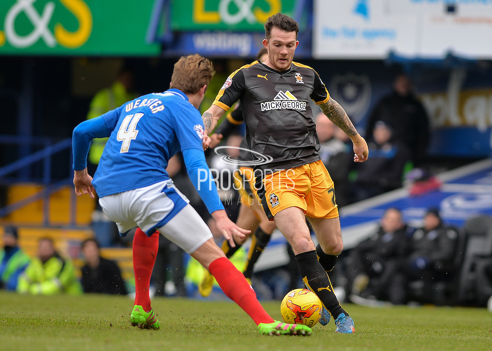 Cambridge United Forward Jimmy Spencer takes on Portsmouth defender Adam Webster during the Sky Bet League 2 match between Portsmouth and Cambridge United at Fratton Park, Portsmouth, England on 27 February 2016. Photo by Adam Rivers.