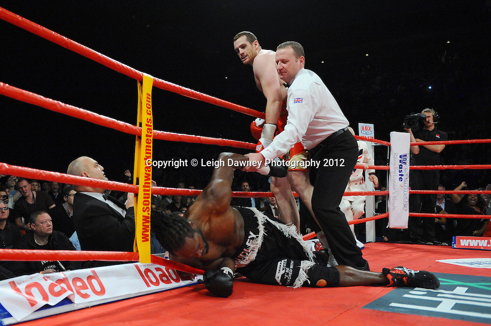 David Price knocks down Audley Harrison and wins to retain the British & CommonwealthTitle at the Echo Arena, Liverpool on 13th October 2012. Frank Maloney Promotions © Leigh Dawney Photography 2012.