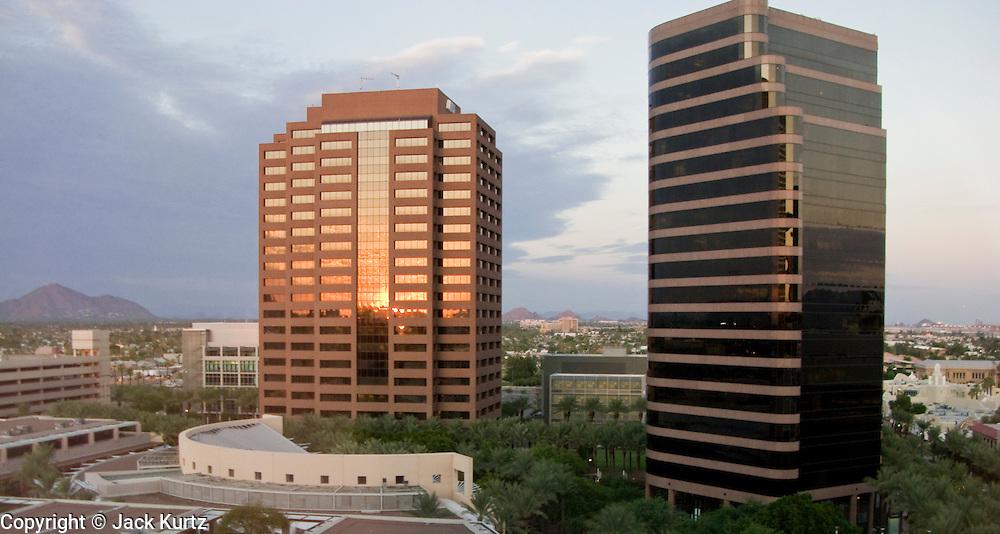 15 AUGUST 2008 -- PHOENIX, AZ: The setting sun casts a golden light on office towers of the Arizona Center, an office complex in downtown Phoenix, Arizona. PHOTO BY JACK KURTZ