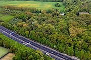 Nederland, Utrecht, Amelisweerd, 09-05-2013; lokatie van (omstreden) verbreding van rijksweg A27. De bak zou verbreed moeten worden aan de zijde van het landgoed )boven in beeld) en van een geluidswerend dak worden voorzien. In het bos kasteel Nieuw Amelisweerd.<br /> Motorway A27, near Utrecht; there are (controversial) plans to broaden the road.<br /> luchtfoto (toeslag op standard tarieven);<br /> aerial photo (additional fee required);<br /> copyright foto/photo Siebe Swart.