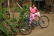 A young girl with her bicycle