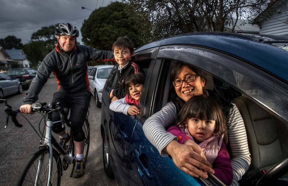 One car household, Damian Walsh ride a bike to work while Junko Kobayashi drives with kids (left to right), Declan 11, Grace 6, and Gabbi 3. Pic By Craig Sillitoe CSZ/The Sunday Age.30/7/2011 melbourne photographers, commercial photographers, industrial photographers, corporate photographer, architectural photographers, This photograph can be used for non commercial uses with attribution. Credit: Craig Sillitoe Photography / http://www.csillitoe.com<br />