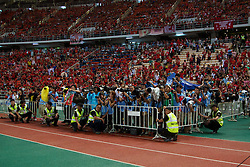 BANGKOK, THAILAND - Sunday, July 28, 2013: Photographers penned into a completely unsuitable position to photograph a trophy presentation during a preseason friendly match at the Rajamangala National Stadium. (Pic by David Rawcliffe/Propaganda)