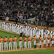 New York Yankees and Houston Astros players during the National Anthem before the New York Yankees Vs Houston Astros, Wildcard game at Yankee Stadium, The Bronx, New York. 6th October 2015 Photo Tim Clayton for The Players Tribune