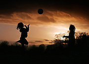14/2/13 Sisters Katie Mae 7 and Ellie 5 O'Sullivan playing football in the Royal Hospital Kilmainham as the sun sets this evening Pic:Marc O'Sullivan