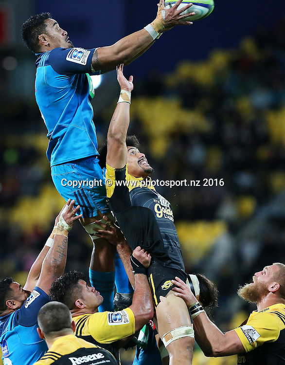 Blues' Jerome Kaino climbs high for a line out ball above Hurricanes' Ardie Savea during the round 15 Super Rugby match, Hurricanes v Blues at Westpac Stadium, Wellington, New Zealand. 2nd July 2016. © Copyright Photo: Grant Down / www.photosport.nz