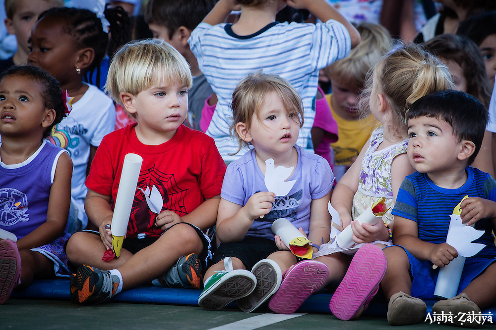 (L-R) Zoe Johnson, Connor Richardson, Aibhlinn Morrison, Kiera McNally and Niccolo Defelice , two and three years old watch the 2012 Peace Day Celebration.  VI Montessori School and International Academy.  21 September 2012.  © Aisha-Zakiya Boyd
