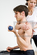 Sports physiotherapy, stabilisation shoulder (model-released)