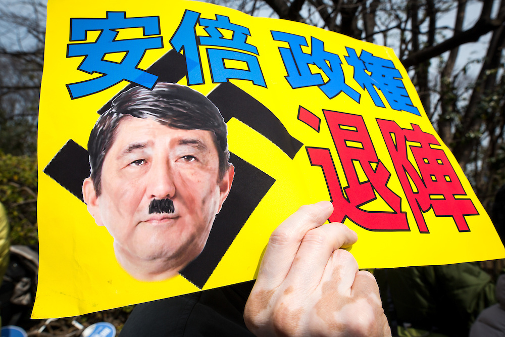 "TOKYO, JAPAN - MARCH 5 : Anti-Abe protesters with placards reading ""Abe government, leave out!"" gather in front of the National Diet Building to protest against the policies of Shinzo Abe and to call on the Japanese prime minister to resign, Tokyo, Japan, March 5, 2017. Japan's ruling party approved a change in party rules Sunday, after an annual convention of lawmakers and members of his ruling Liberal Democratic Party (LDP) that could pave the way for Prime Minister Shinzo Abe to become the country's longest-serving leader in the post-World War II era. (Photo: Richard Atrero de Guzman/NUR Photo)"