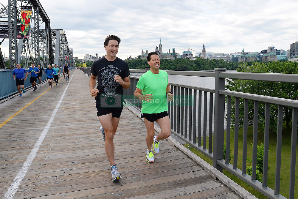 Prime Minister Justin Trudeau and Mexican President Enrique Pena Nieto run across the Alexandra Bridge from Ottawa to Gatineau, Quebec, Canada on June 28, 2016. Photo by Sean Kilpatrick/The Canadian Press/ABACAPRESS.COM  | 553158_005 Ottawa Canada